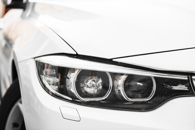 Stylish headlight of white car
