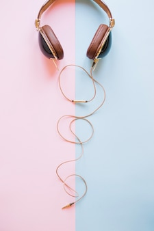 Stylish headphones on light background