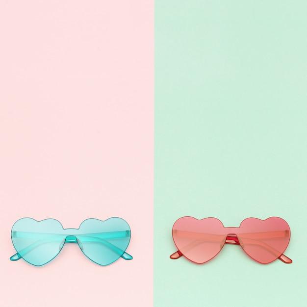 Stylish heart shaped glasses on paper