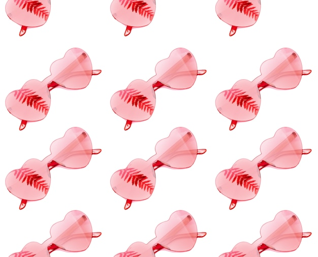 Stylish heart shaped glasses seamless pattern with shadow from palm leaves on white