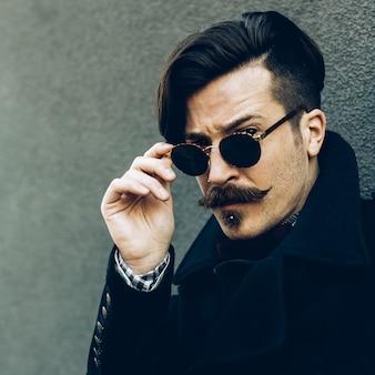 Stylish hipster man. autumn fashion look