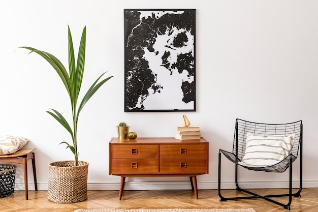 Stylish interior design of living room with wooden retro commode, chair, tropical plant in rattan pot, basket and elegant personal accessories. frame on the wall. home decor.