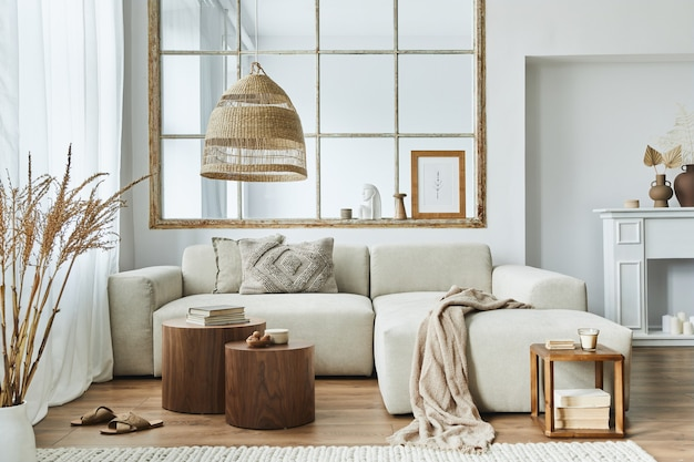 Stylish interior of living room with design modular sofa, furniture, wooden coffee table, rattan decoration.