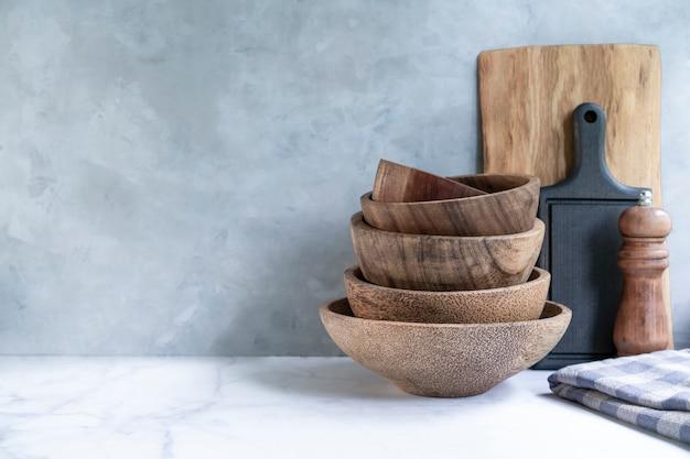Stylish kitchen background with kitchen utensils on marble countertop