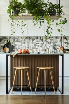 Stylish kitchen interior design with dining space. workspace with kitchen accessories on the back ground. creative walls. minimalistic style an plant love concept.