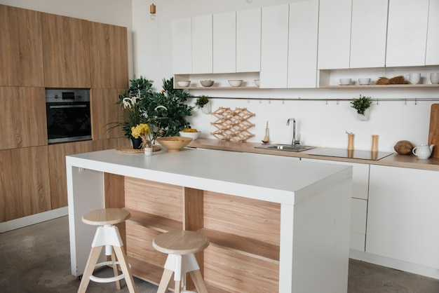Stylish kitchen in white and brown wood. style minimalism.