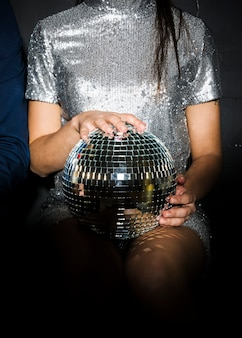 Stylish lady with disco ball