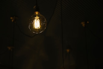 Stylish light bulb on ceiling