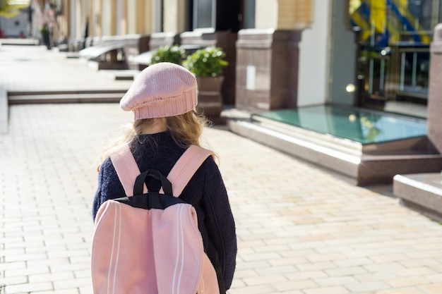 Stylish little girl with backpack