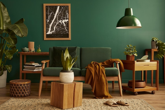 Stylish living room in house with modern retro interior design, velvet sofa, carpet on floor, brown wooden furniture, plants, poster map, book, lamp and personal accessories in home decor