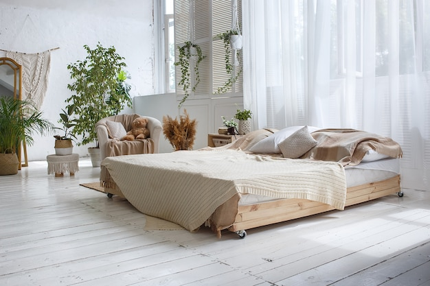 Stylish loft cozy bedroom with double bed, armchair