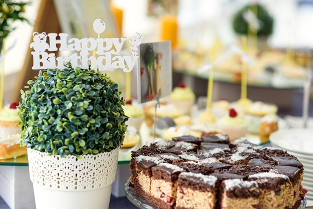 Stylish luxury decorated candy bar for birthday celebration, catering in the restaurant.