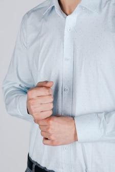 Stylish man in blue shirt on grey