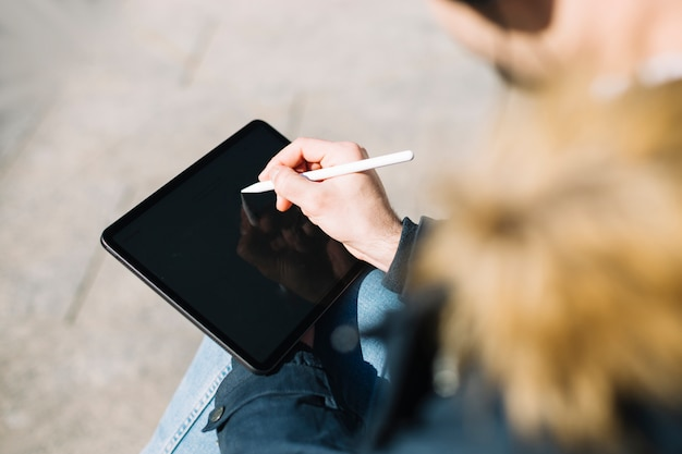 Stylish man drawing on tablet