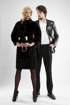 Stylish man and glamour woman in fur coat posing