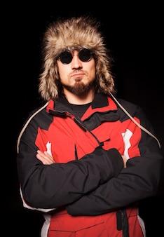 Stylish man posing in winter clothing