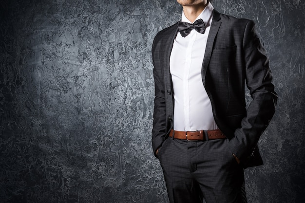 Stylish man in suit with bow tie