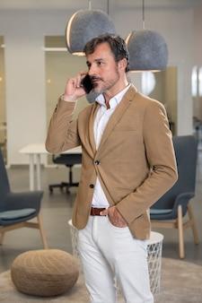 Stylish man talking on phone