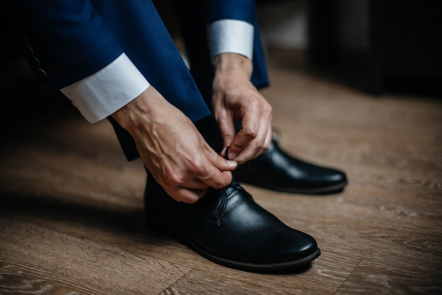 A stylish man wears classic shoes close-up. fashion.