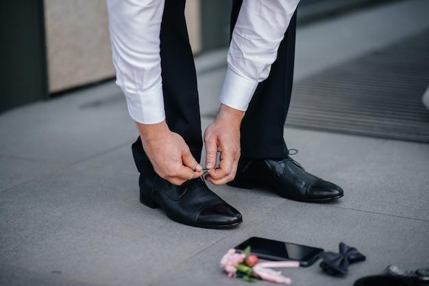 A stylish man wears classic shoes close-up. fashion.