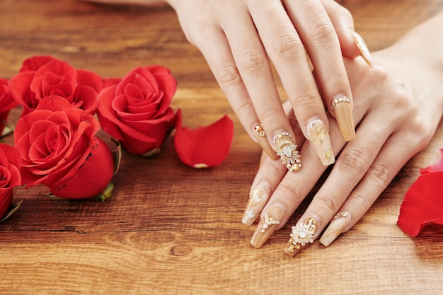 Stylish manicure and rose flowers
