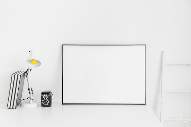 Stylish minimalistic workplace in white color with whiteboard