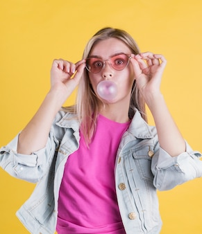 Stylish model blowing bubble gum