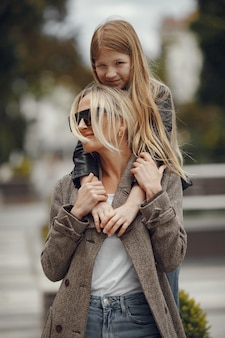 Stylish mother with daughter in a summer city
