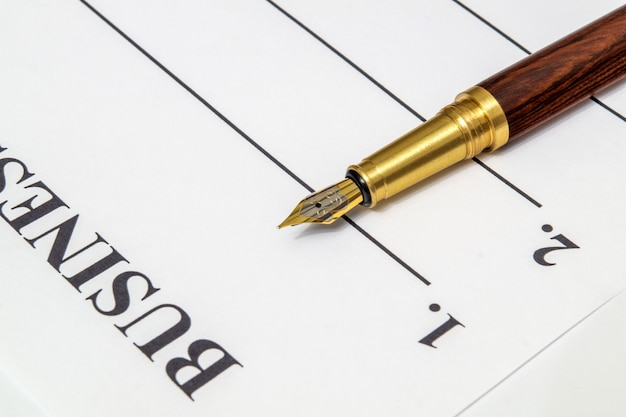 Stylish a pen lies on a business plan form in front of notes