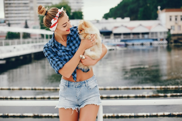 Stylish pin up girl with the little dog