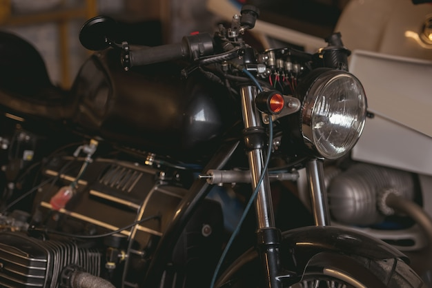 Stylish powerful motorcycle in the modern repair shop