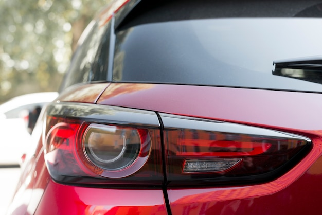 Stylish rear light on new red automobile