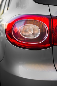 Stylish rear light on new silver car