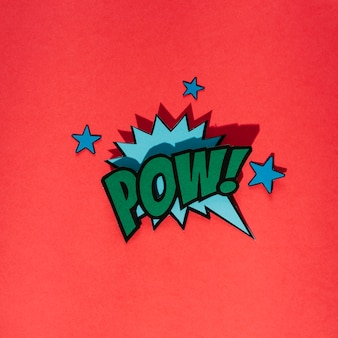 Stylish retro comic speech bubble with pow text with star elements on red background