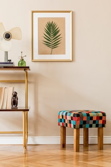 Stylish and retro space of home interior with wooden frame stool and shelf with elegant accessories and plants cozy home decor home staging beige concept of living room