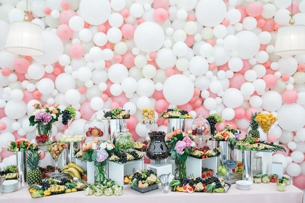 Stylish and rich table with sweets and fruits for guests