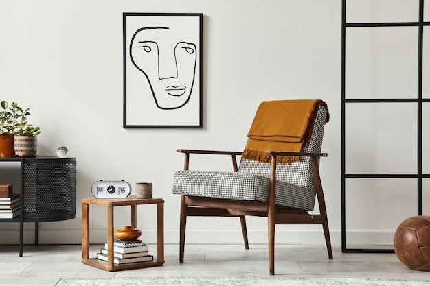 Stylish scandinavian composition of living room with design armchair, black mock up poster frame, commode, wooden stool, plant, decoration, loft wall and personal accessories in modern home decor.