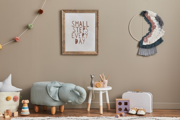 Stylish scandinavian kid room interior with toys, elephant pouf, plush animal toys, furniture, decoration and child accessories