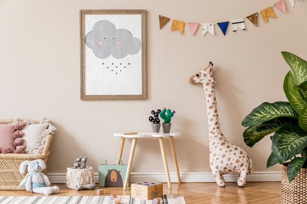 Stylish scandinavian kid room with mock up poster, toys, teddy bear, plush animal, natural pouf and children accessories. modern interior with beige background walls. template. design home staging. Premium Photo