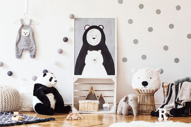 Stylish scandinavian kid room with poster, toys, teddy bear, plush animal, natural pouf and children accessories