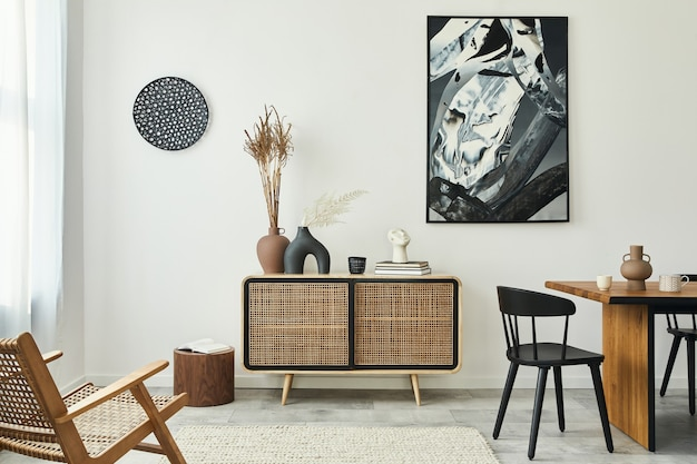 Stylish scandinavian living room interior of modern apartment with wooden commode, design table, chairs, carpet, abstract paintings on the wall and personal accessories in unique home decor..