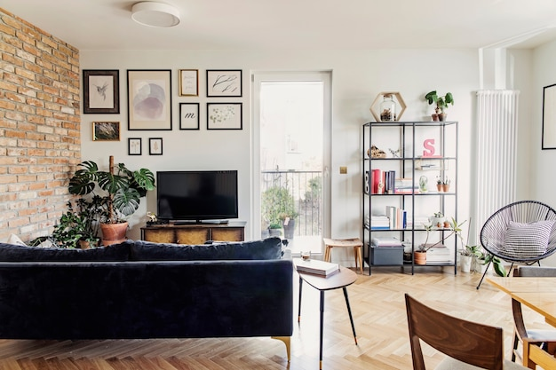 Stylish scandinavian living room open space  with design sofa and bookstand