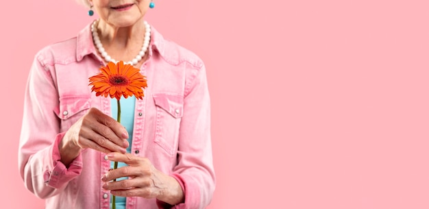 Stylish senior woman model in pink