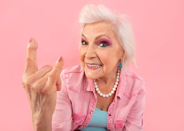 Stylish senior woman in pink