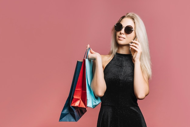 Stylish shopper talking on smartphone