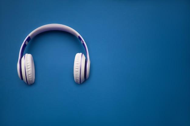 Stylish silver dj headphones. minimal concept. creative flat lay photo with earphones.