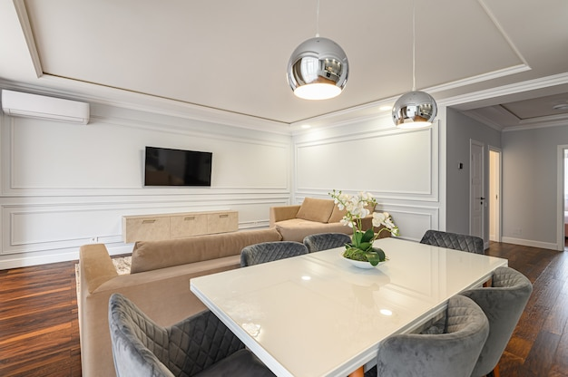 Stylish and simple white and beige contemporary classic interior of studio flat designed in modern style