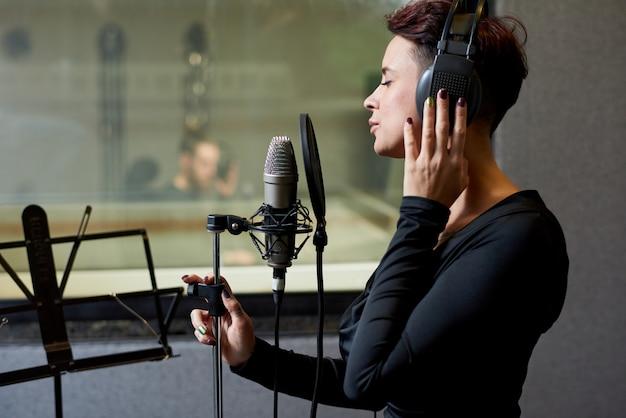 Stylish singer recording sing