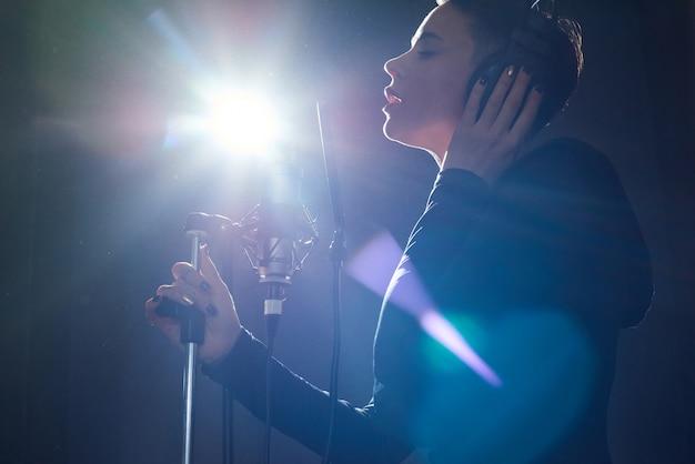 Stylish singer in recording studio