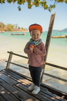 Stylish smiling little boy in baseball hat